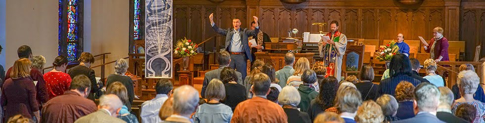 Stephen Harouff and Pastor Joel Strom leading worship at Towson Presbyterian Church with their congregation.